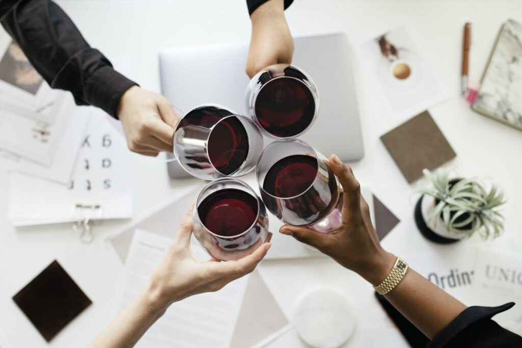 Professional business celebrating with wine